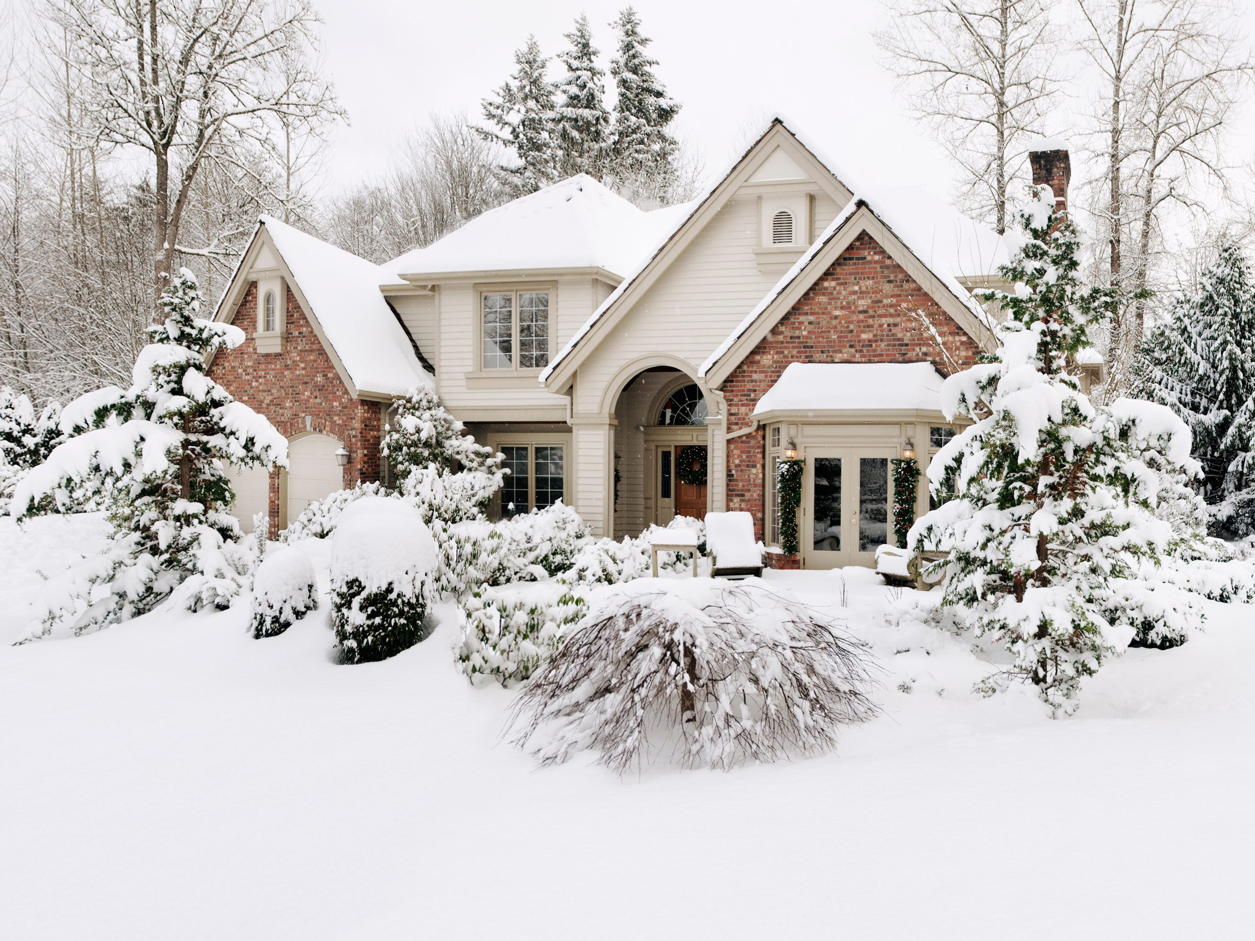 snowy house in the winter time.