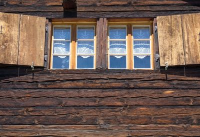 two-windows-of-a-wooden-hut-P8PWEJE