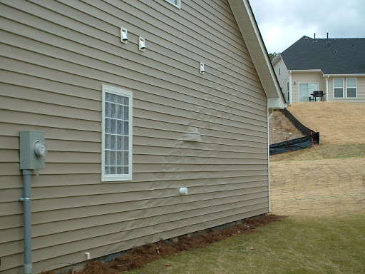 old siding on house that is falling off